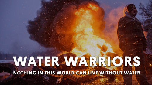 A person stands with a pile of burning tires behind them. The title overlaid: Water Warriors: Nothing in this world can live without water.